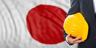 Engineer on a Japan flag background. 3d illustration. Engineer on a waiving Japan flag background. 3d illustration Royalty Free Stock Photos