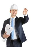 Engineer keeps blueprints and waves hand. Engineer in hard hat keeps blueprints and waves hand, isolated on white. Concept of successful construction Stock Image
