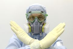 An engineer of laboratory wearing a special uniform and protective glasses and face mask against chemical poison show. An engineer of laboratory wearing a royalty free stock images