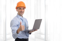 Engineer with laptop. Computer showing his thumb up Royalty Free Stock Image