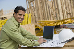 Engineer With Laptop At Construction Site Stock Image