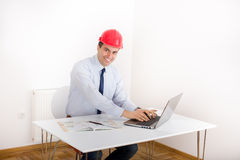Engineer with laptop in the office Royalty Free Stock Image