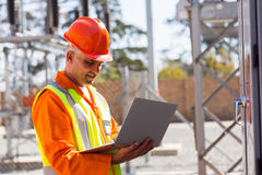 Engineer laptop substation Royalty Free Stock Photos