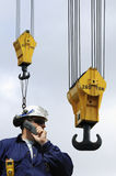 Engineer and large crane hooks Royalty Free Stock Images