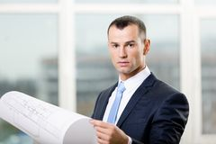 Engineer with layout. Engineer wearing suit and necktie hands layout Royalty Free Stock Photo