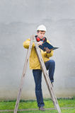 Engineer leaned on ladder Royalty Free Stock Image