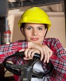 Engineer Leaning On Steering Wheel Of Forklift Royalty Free Stock Photo