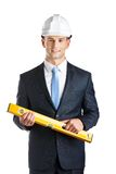 Engineer with level. Engineer in hard hat keeps level, isolated on white Royalty Free Stock Image