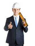 Engineer with level thumbs up. Engineer in hard hat keeps level and thumbs up, isolated on white Royalty Free Stock Photo