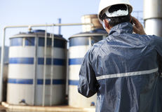 Engineer on location site. And storage tank Stock Photo