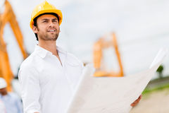 Engineer looking at blueprints Royalty Free Stock Photos