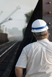 Engineer Looking Down Track. To check progress of train interruption Royalty Free Stock Photo