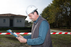 Engineer looking at his tablet Stock Photography