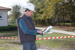 Engineer looking at his tablet Royalty Free Stock Images