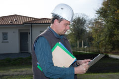 Engineer looking at his tablet Royalty Free Stock Photography