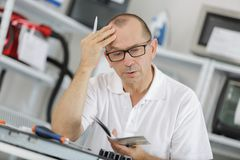 Engineer looking in plan air conditioning system stock photos