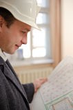 Engineer looking at plans. Royalty Free Stock Image