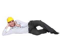 Engineer lying on the floor Royalty Free Stock Photo