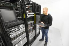It engineer maintains servers in datacenter Royalty Free Stock Photos