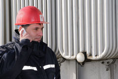 Engineer  make call in power plant Royalty Free Stock Photography