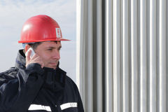 Engineer  make call in power plant Stock Photography