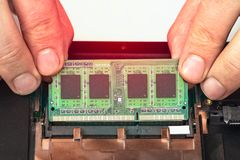 Engineer makes dismantling of RAM for disassembling and repairing a laptop royalty free stock photo
