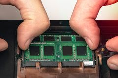 Engineer makes dismantling of RAM for disassembling and repairing a laptop royalty free stock image
