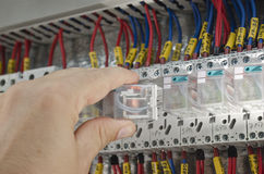 Engineer makes maintenance. Of power network automation Stock Photo