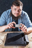 Engineer makes shoot of laptop on phone camera Royalty Free Stock Photos