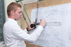 Engineer making a blueprint project with drawing board Stock Photos