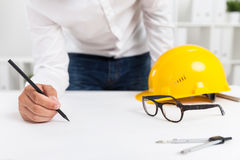 Engineer making blueprint Stock Images