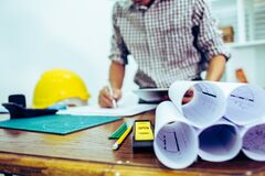 Free Engineer Man And Architect Drawings Blueprint At Construction Site.office Project Management Stock Images - 182528744