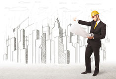 Engineer man with building city drawing in background Royalty Free Stock Photography