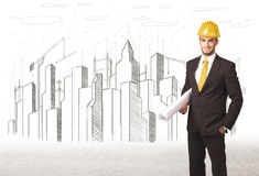 Engineer man with building city drawing in background Stock Photo