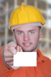 Engineer man holding blank business card Stock Images