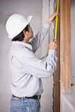 Engineer man metering by tape measure Royalty Free Stock Photography