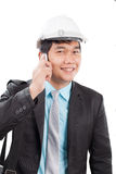 Engineer man talkin on mobile phone and smiling with happy emoti Royalty Free Stock Photo
