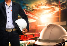 Engineer man with white safety helmet standing against working t Royalty Free Stock Photos