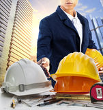 Engineer man and working table against sky scrapper in urban sce Royalty Free Stock Photography