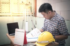 Engineer manager. Working document about progress of work schedule on the construction job site Royalty Free Stock Photo