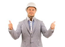 Engineer or manager showing thumbs up. Professional engineer or manager wearing white hardhat while showing thumbs up or pointing upwards, portrait on white Royalty Free Stock Photo