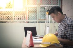 Engineer manager feel so serious. Engineer manager working document about progress of work schedule on the construction job site Royalty Free Stock Photo