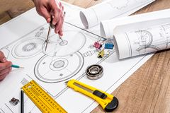 Engineer measures the dimensions. Of the drawing Royalty Free Stock Photos