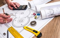 Engineer measures the dimensions. Of the drawing Stock Photos