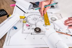Engineer measures the dimensions. Of the drawing Royalty Free Stock Images