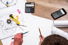Engineer measures the dimensions. Of the drawing Stock Photography