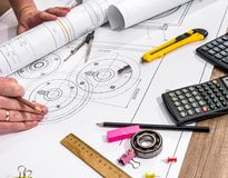 Engineer measures the dimensions. Of the drawing Stock Images