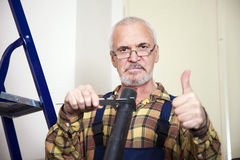 Engineer measures with tool the size of the pipe. In the room Royalty Free Stock Photo