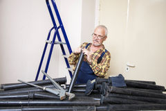 Engineer measures with tool the size of the pipe. In the room Royalty Free Stock Images