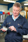 Engineer Measuring Component With Micrometer Royalty Free Stock Photos